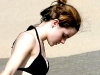 Emma Watson sun bathing in a bikini while on vacation with her boyfriend Jay Barrymore in Jamaica. The couple spent a day lounging in the sun and swimming together.